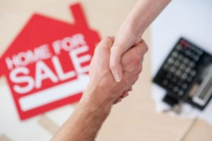 Real Estate Agent shakes hands with seller
